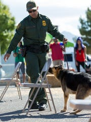 U.S. Border Patrol officer Daniel Barron demonstrates drug detection with his dog Tarra-a on Saturday, September 24, 2016, during a Dog Days event hosed by Horse N Hound.