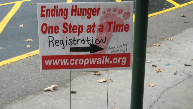 A sign directs people who want to register for the Northern Dutchess County CROP Hunger Walk.