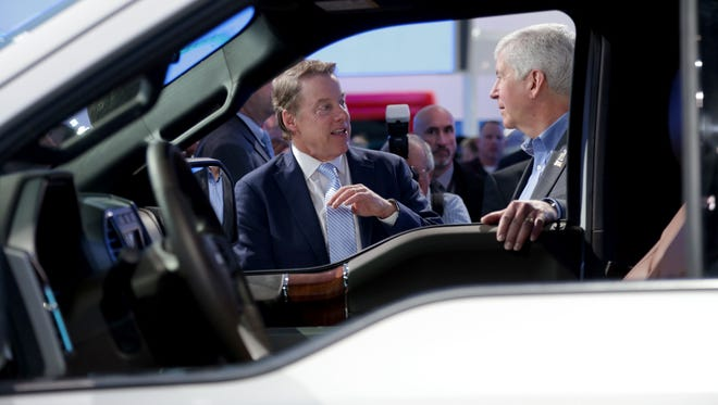 Ford Executive Chairman Bill Ford Jr. and Gov. Rick Snyder talk in front of the 2018 Ford F-150 at the Ford display during the 2017 North American International Auto Show held at Cobo Center in downtown Detroit on Monday, Jan. 9, 2017. Snyder came to look at the autonomous cars Ford is working on and tour the show floor.