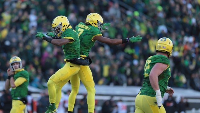 Nov 27, 2015; Eugene, OR, USA; Oregon Ducks defensive back Arrion Springs (1) and wide receiver Darren Carrington (7) celebrate following a touchdown against the Oregon State Beavers at Autzen Stadium. Mandatory Credit: Scott Olmos-USA TODAY Sports