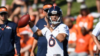 Denver Broncos quarterback Mark Sanchez (6) prepares to pass during training camp drills held at the UCHealth Training Center.
