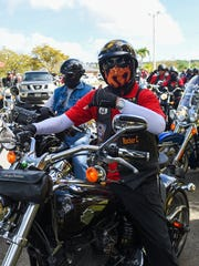Members of the Guam Hawgs Motorcycle Club get ready for their annual candy run in Hagatna on Dec. 13.
