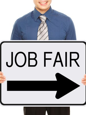 A man advertising a Job Fair signboard or poster