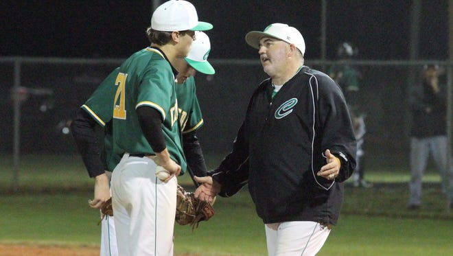 Pensacola Catholic baseball coach Sonny Reedy visits the mound and talks with pitcher Steve Halstead. Reedy resigned as Catholic's coach on Monday.