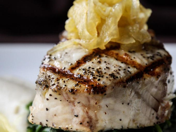Chuck Lesbirel's grilled Atlantic coast swordfish  with sunchoke puree, fennel marmalata and orange sugo.
