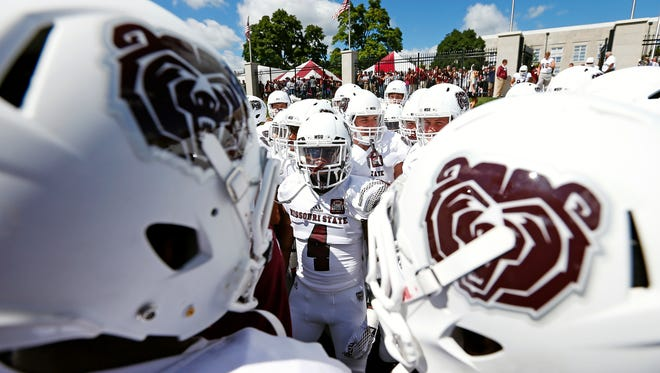 Missouri State Bears cornerback Matt Rush (4) and his teammates huddle up before taking the field prior to their home opener game against the Chadron State Eagles at Plaster Field in Springfield, Mo. on Sept. 12, 2015.