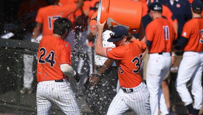 Auburn freshman Conor Davis (24) getting a water shower from Bo Decker (35) after his walk-off 3-run home run to defeat South Carolina 6-5 on Sunday, April 2, 2017.