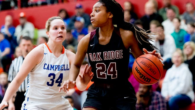 Oak Ridge's Jada Guinn (24) looks to pass as Campbell County's Haley Comer (34) defends during the District 3AAA finals game at Halls High School in Halls, Tennessee on Saturday, February 17, 2018.