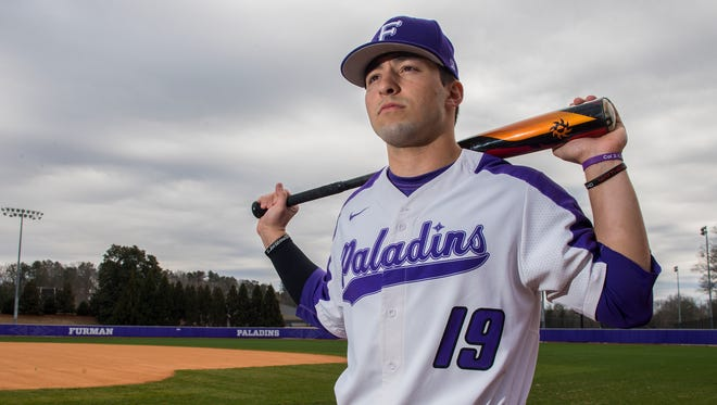 Furman's Jake Crawford poses wearing his new jersey number, 19, that he is wearing in honor of his former B-HP high school teammate Blake Holliday who died last October after an ATV accident.