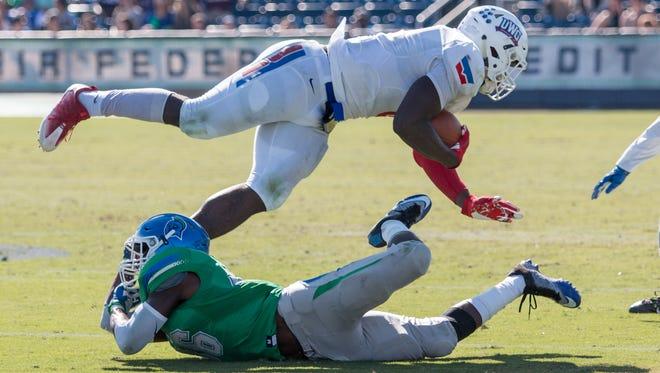 West Florida's Sam Adams (36) tackles West Georgia tight end Alex Armah (8) during the last game of the inaugural 2016 season for the Argos Saturday afternoon at Blue Wahoos Stadium.