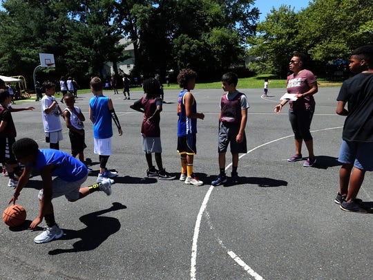 Former South River basketball star Audrey Taylor, who is the Courier News' reigning Coach of the Year after leading Franklin High School to the prestigious Tournament of Champions title, conducting a free clinic in her native South River for basketball players of all ages on Sunday, July 30, 2017. The clinic, called Ballin' in the Park, is part of Taylor's passion4youth nonprofit.