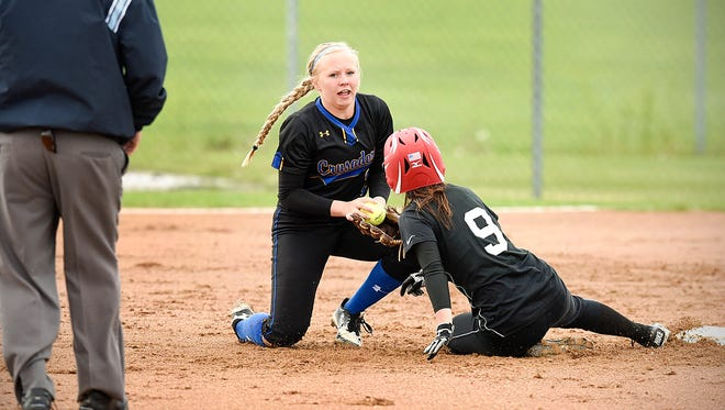 St. Cloud Cathedral's Abbey Medelberg is shown making a play last season on Pierz's Hannah Kahl at second base. The top-seeded Crusaders have a Section 6-2A winners' bracket game against Annandale at 5 p.m. Tuesday at River's Edge Park in Waite Park.