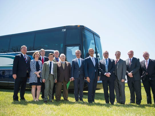 At center Gov. Bill Haslam and to his right Van Hool