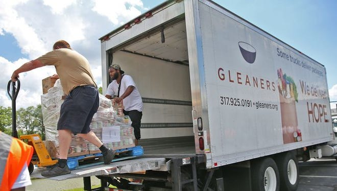 Food is unloaded for the kick-off to the Gleaners Care Mobile Food Pantry. Gleaners will receive a $100,000 grant to make it easier for SNAP recipients to buy fresh fruits and vegetables.