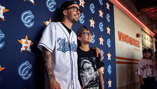 "Chauncey Leopardi (left), who played Squints in ""The Sandlot,"" takes a photo with Jayden Ramirez, 10, during an appearance at a Hooks game at Whataburger Field on Saturday, April 28, 2018."