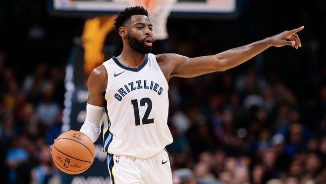 Memphis Grizzlies guard Tyreke Evans (12) motions in the fourth quarter against the Denver Nuggets at the Pepsi Center.