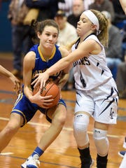 Lebanon Catholic's Taylor Bossert, right, tries to take the ball away from Northern Lebanon's Zara Zerman.