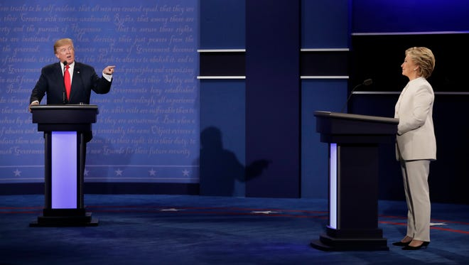 Democratic presidential nominee Hillary Clinton listens to Republican presidential nominee Donald Trump during the third presidential debate at UNLV in Las Vegas on Oct. 19, 2016.