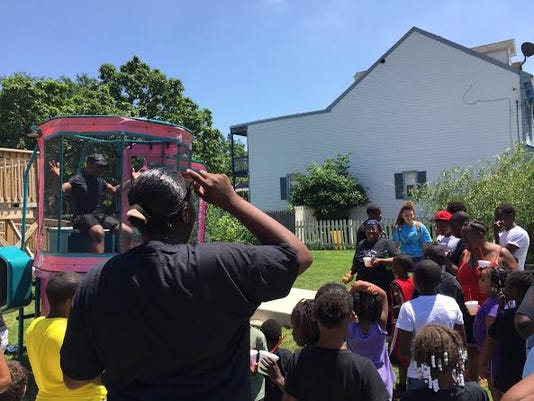 A crowd lines up for a chance to dunk the Rev. Thaddeus Godwin of Mount Calvary Baptist Church in York during the church's first Youth Day block party on Saturday.