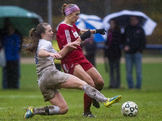 Colchester's Clara Johnson, left, contests the ball against CVU's Natalie Durieux in Colchester on Wednesday, October 28, 2015.