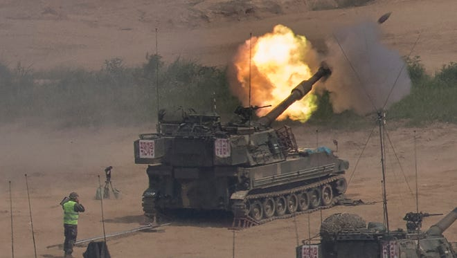 In this Monday, May 22, 2017 photo, South Korean army's K-55 self-propelled howitzer fires during the annual exercise in Paju, near the border with North Korea, South Korea.