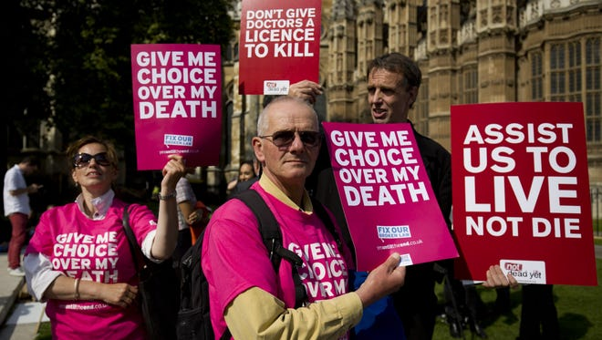 Demonstrators for and against assisted suicide in London on Sept. 11, 2015.