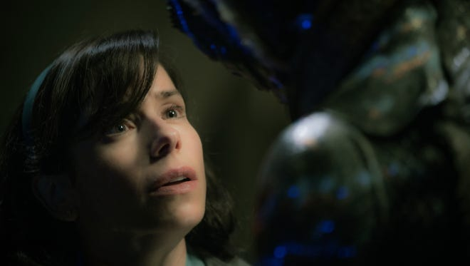 Elisa (Sally Hawkins) shares a moment with her beloved Amphibian Man (Doug Jones) in Guillermo del Toro's 'The Shape of Water.'