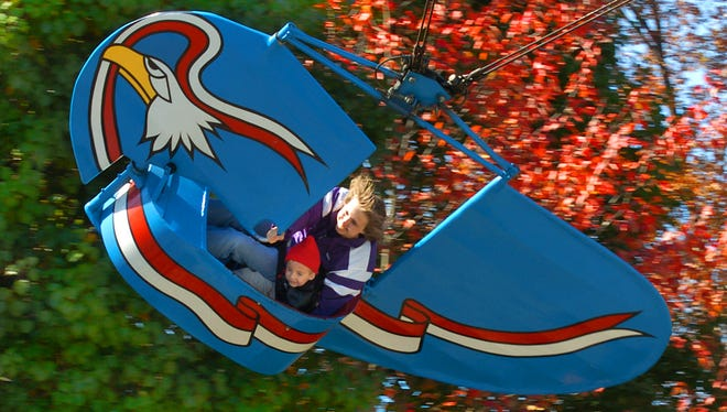 A Rhonda Parker and her two year-old son Ian ride the Flying Eagles ride at Paramount's Kings Island in Mason Sunday on the last day of operation for the popular family ride. The Parker family came down from Muncie Indiana just to ride it one last time. The ride is being moved to a sister park in North Carolina.