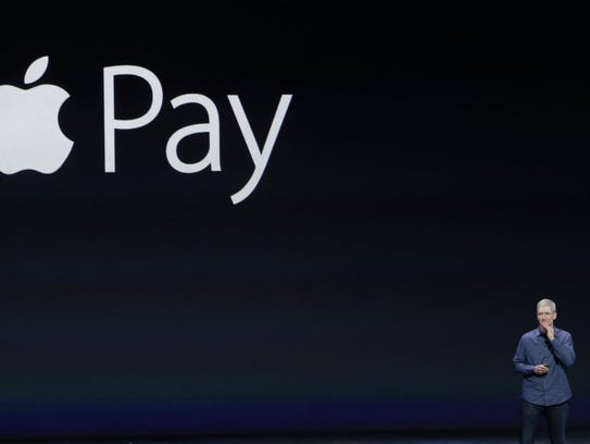 Apple CEO Tim Cook announces his company's mobile payment