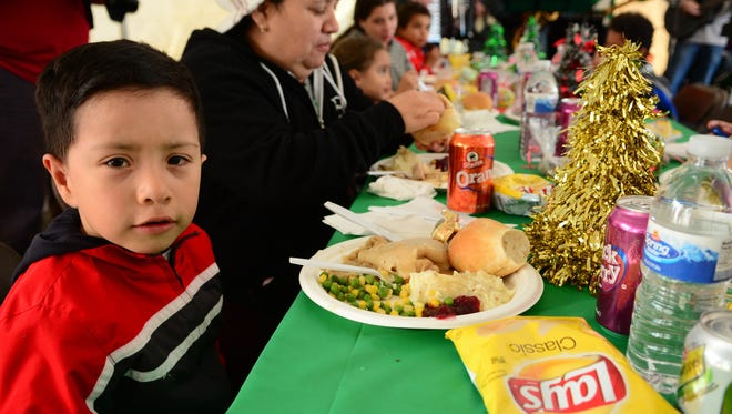Jose Castellanos of Asbury Park sits down to a traditional Thanksgiving dinner courtesy of Holiday Express and the Jersey Shore Rescue Mission on Memorial Drive in Asbury Park.