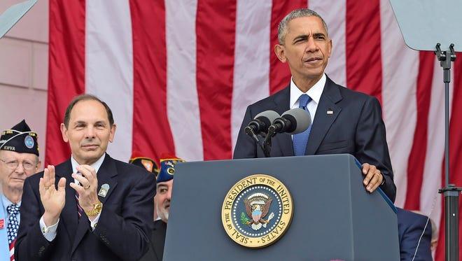 President Obama makes remarks alongside Secretary of Veterans Affairs Robert McDonald at Arlington National Cemetery on Nov. 11, 2016.
