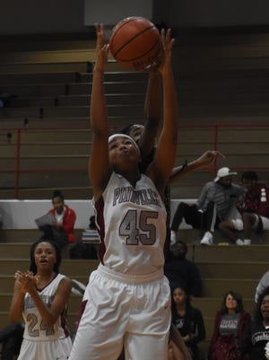 Pineville's Elazia Washington (45) goes up for a rebound against Neville High School Tuesday, Nov. 27, 2018. The Lady Rebels fell 56-29.