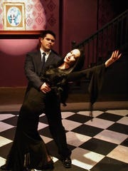 "Lisa Irion, right, plays Morticia and Luke Nettles stars as Gomez in the Abbey Players' production of ""The Addams Family Musical."""