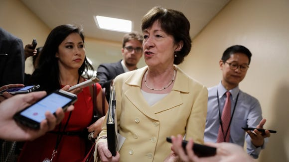 Sen. Susan Collins, R-Maine, talks to reporters at the Capitol on June 21, 2017.