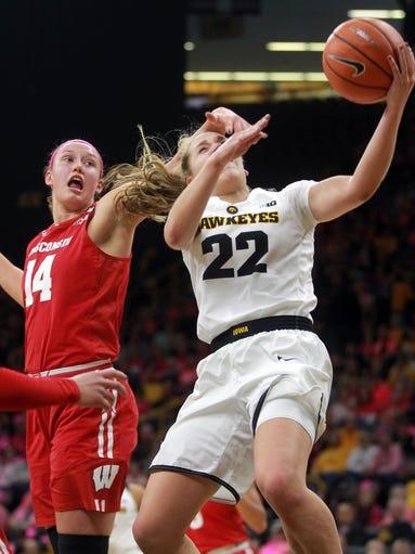 Iowa's Kathleen Doyle draws a foul during the Hawkeyes'