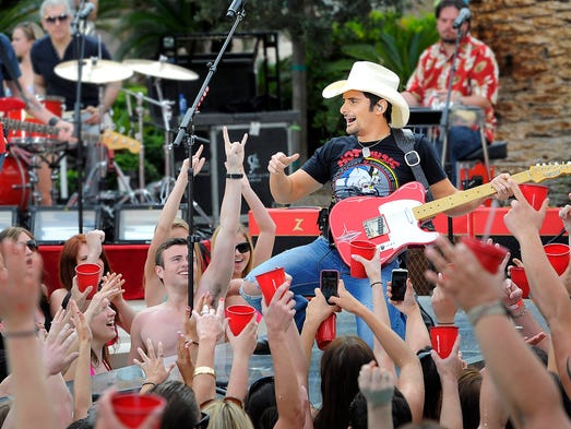 """Brad Paisley will debut his new single """"River Bank"""" with a pre taped segment that was shot at the MGM pool on Friday for the ACM Awards Show that includes him singing on stage surrounded by fans in bathing suit cheering him on from the pool. Friday April 4, 2014, in Las Vegas, NV."""