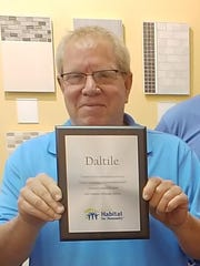 Brad Dixon of Daltile participates in the St. Lucie Habitat for Humanity In-kind Corporate Donor Program.