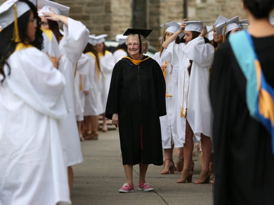 Head of School Cindy Mann walks among her senior class as Padua Academy honors 151 graduates in a commencement ceremony at St. Anthony of Padua, Thursday, May 31, 2018 in Wilmington.