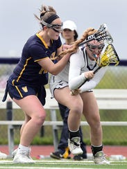 Courtney Burke, right, is at the top of a pack of Pittsford scorers.