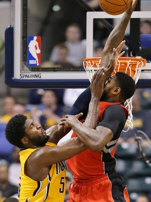 Pacers center Roy Hibbert stuffs Toronto's Amir Johnson as he went to slam dunk the ball in the first half of the game at Bankers Life Fieldhouse on Monday, March 16, 2015.