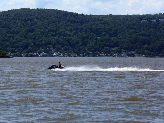 A jet skier travels south on the Hudson River June