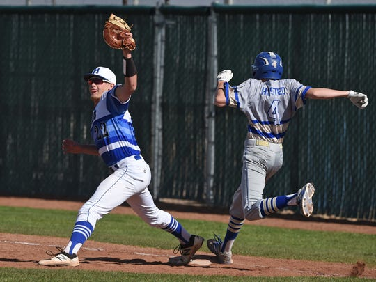 McQueen's Mason Winship gets Reed's Dylan Husted out at first during Tuesday's game at McQueen.