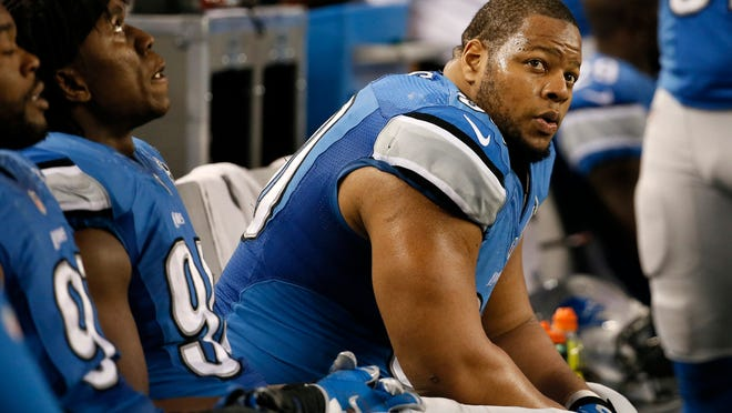 Detroit Lions defensive tackle Ndamukong Suh watches action from the sideline during the second half of an NFL wildcard playoff football game against the Dallas Cowboys, Sunday in Arlington, Texas.