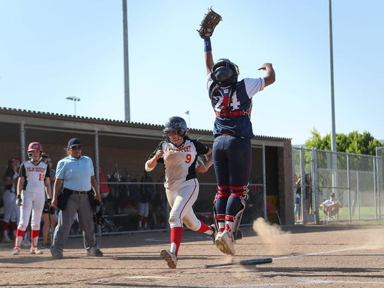 Bayley Gonzalez scores a run against St. Paul, May
