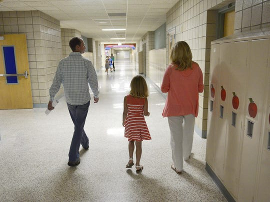Lance and Stacy McNab walk through the hallways of