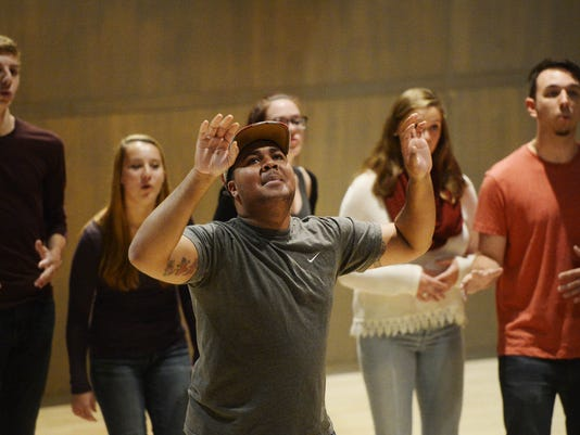 DeJour Hood of Atlantic City, N.J., takes a solo while performing with members of student a cappella group YCP Rhapsody at York College in Spring Garden Township. Kate Penn, York Daily Record