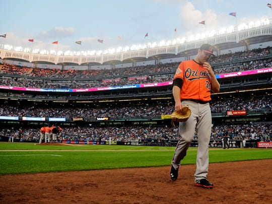 Baltimore Orioles starting pitcher Chris Tillman (30) leaves the game during the second inning of a baseball game against the New York Yankees, Saturday, June 10, 2017, in New York.