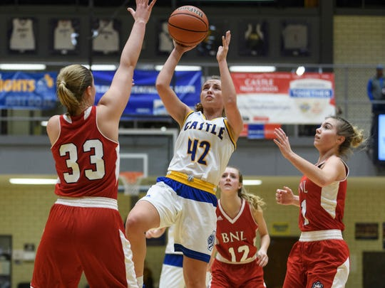 Castle's Josie Freeman (42) attempts a shot during the second quarter against the Bedford North Lawrence Stars at Castle High School in Evansville, Ind., Saturday, Jan. 6, 2018. The Knights defeated the Lady Stars, 62-50.