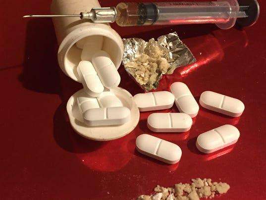636210623058110150-pill-heroin.jpg