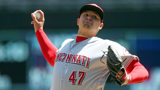 Cincinnati Reds' pitcher Sal Romano throws against the Minnesota Twins in the first inning of a baseball game Saturday, April 28, 2018, in Minneapolis.